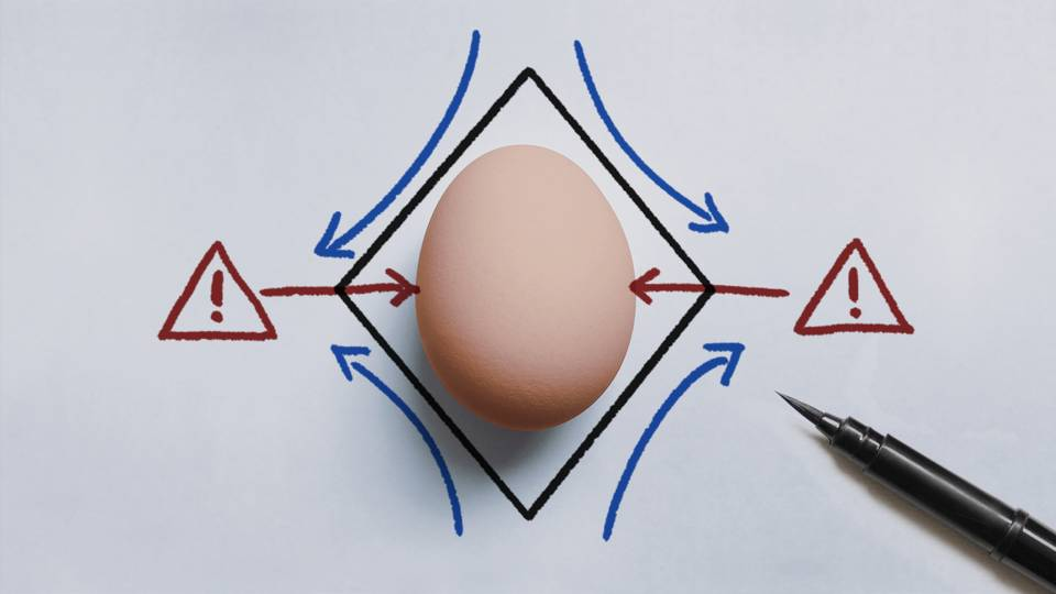 An egg being measured